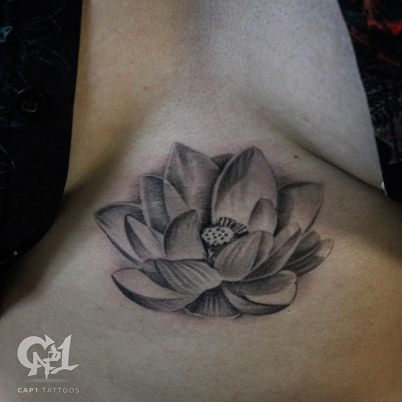 Lotus Flower Sternum Tattoo By Capone Tattoonow
