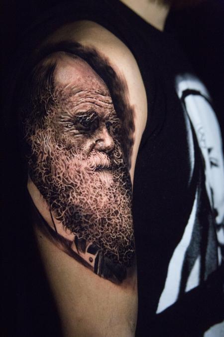 Carlos Ortiz - black and grey Darwin portrait tattoo
