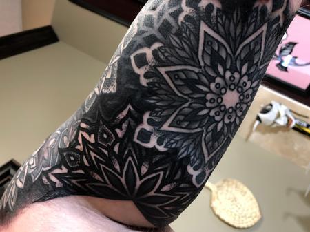 Christina Walker - Underarm of finished geometric and mandala half sleeve