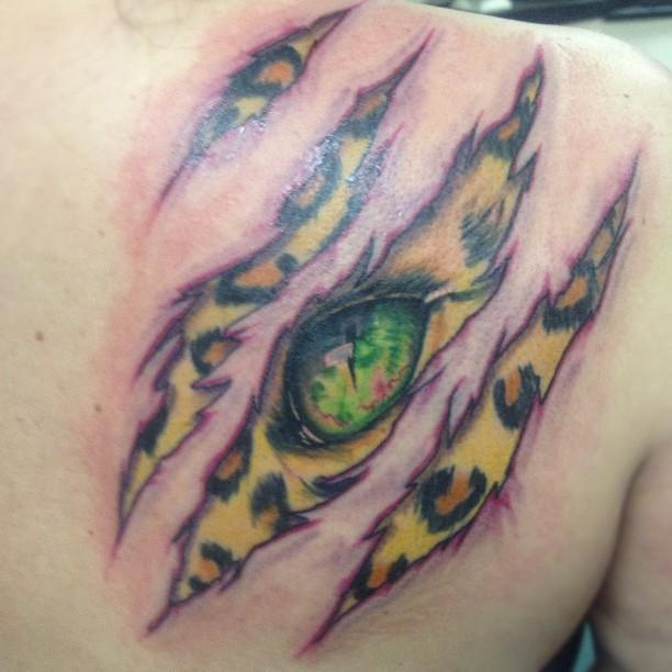 Leopard skin rip by brian gallagher tattoonow for Living dead tattoo haverstraw ny