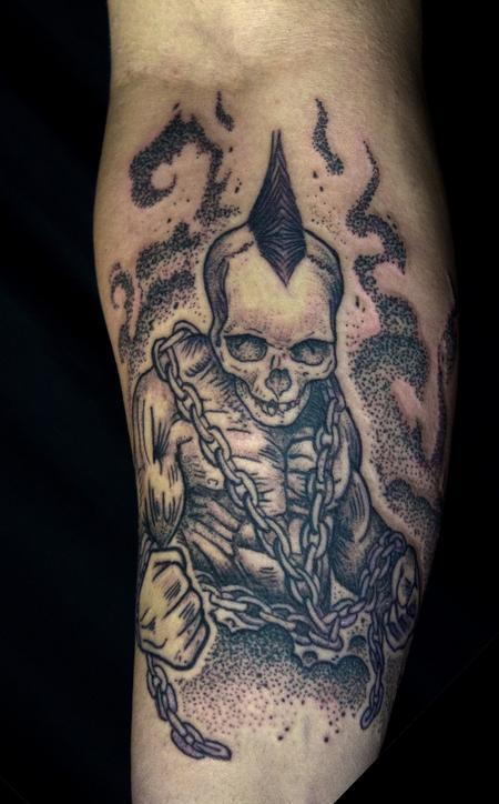 Ben Licata - Skull headed muscle dude with chains tattoo on forearm