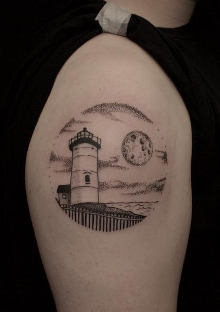Ben Licata - Black stippled lighthouse and moon tattoo on shoulder