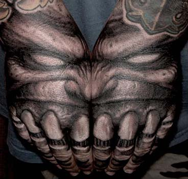 Paul Booth - Demon with teeth hand tattoo