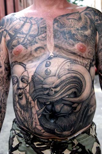 Paul Booth - Horned helmet demon stomach tattoo