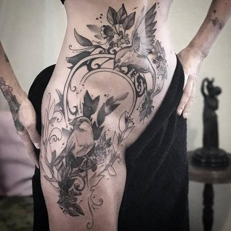 Tattoos - Birds, flowers, vines with Art Nouveau filigree on model's hip. Black and grey.  - 130519