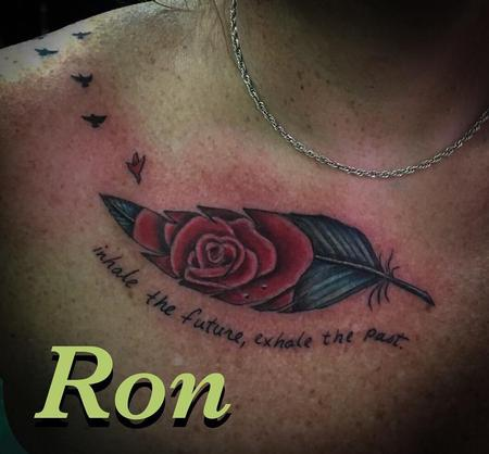 Rose in feather memorial tattoo