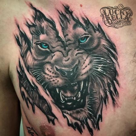 Tattoos - tiger skin rip - 130504