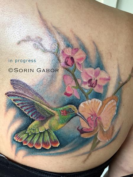 Sorin Gabor - realistic color hummingbird and orchids tattoo