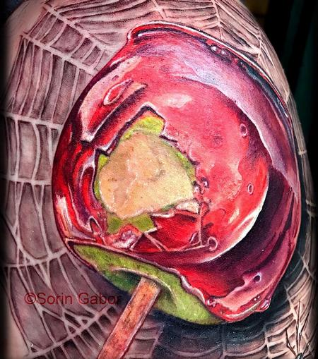 Tattoos - realistic color candy apple on spiderweb tattoo  - 131438