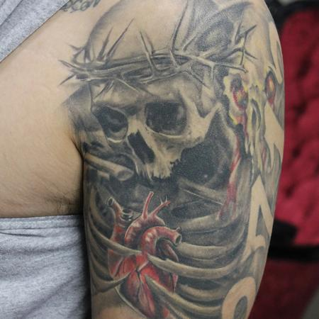 Capone -  Healed Black and Grey Skull and Rib Cage Sleeve with a realistic color heart