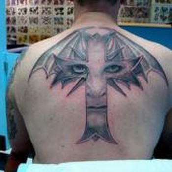 Tattoos - Face in a cross - 49330