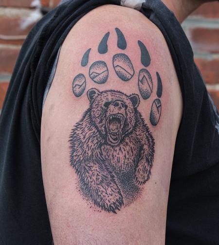 Ben Licata - Bear in bear paw tattoo on shoulder