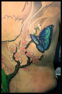 Lux Altera - Butterfly and Flower backpiece in progress