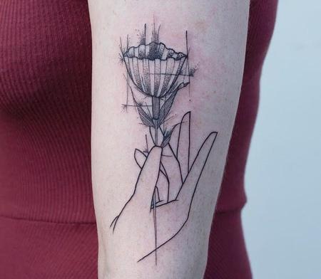 Gio Luca - Hand holding flower tattoo