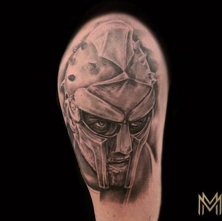Black and Gray Gladiator Portrait Tattoo