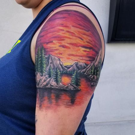 color trees sunset mountain range shoulder tattoo