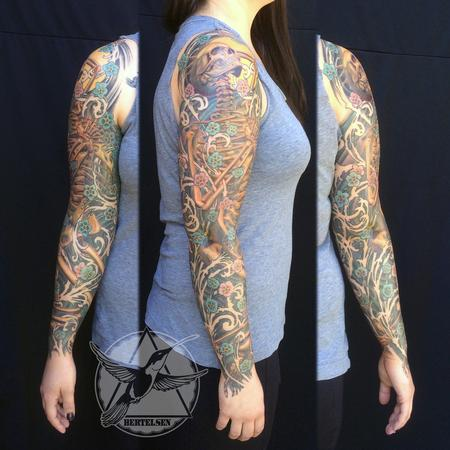 Jake Bertelsen - Full sleeve skeleton and forget me not flowers