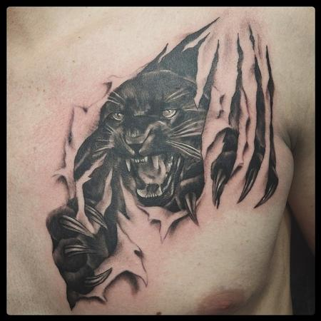 Tattoos - panther ripping through skin - 113752