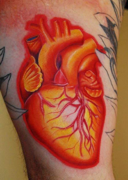 Tattoos - he's got a raging Heart On... - 59691