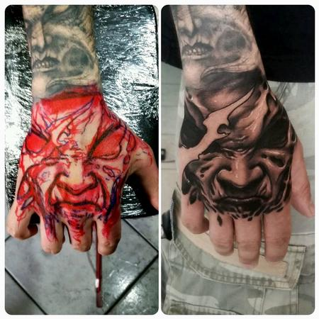 Tattoos - evil face on hand - 128777