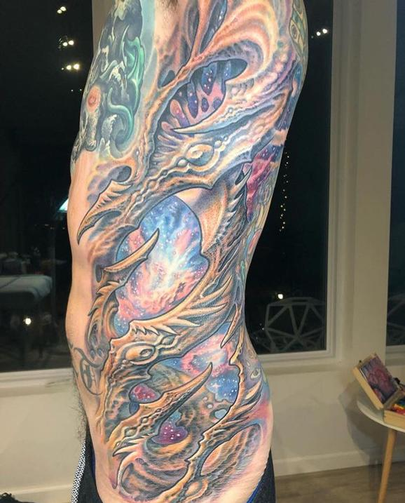 Guy Aitchison - Bio Space Rib Tattoo