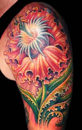 Guy Aitchison - flower tattoo