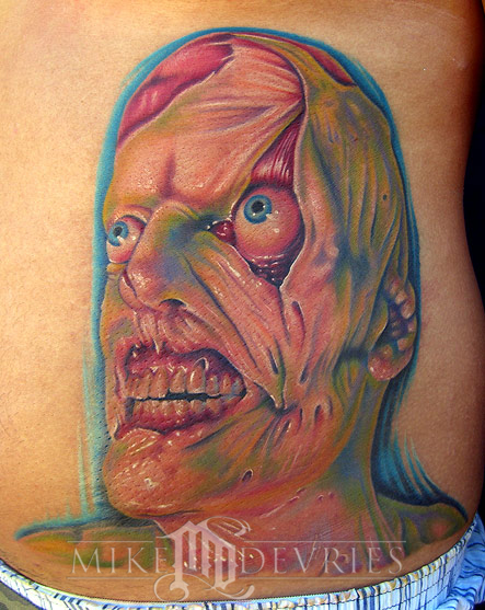 Mike DeVries - Creepy face Tattoo
