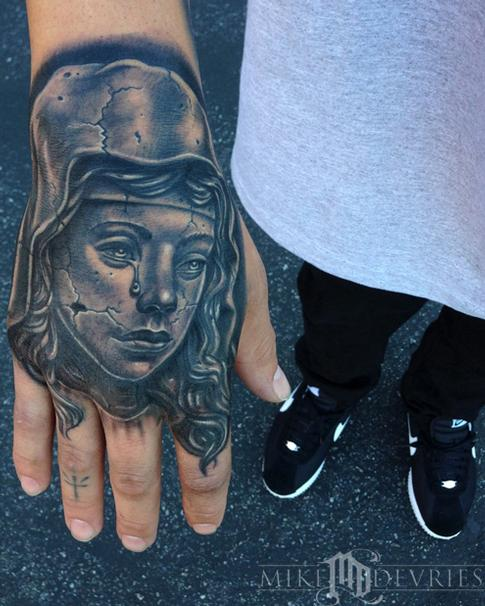 Mike DeVries - Statue Tattoo