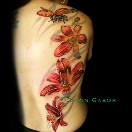 Tattoos - Realistic color feminine tattoo of lillies and flying ladybug - 112099