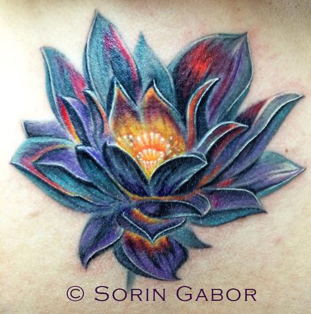 Sorin Gabor - realistic color lotus coverup over old scarred tattoo