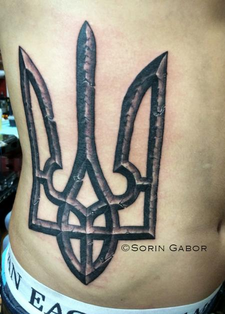Tattoos - Realistic stone Ukrainian coat of arms on ribs black and gray - 98063